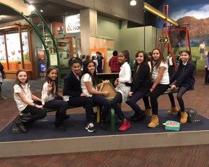 Students on the seesaw in Museum of Science