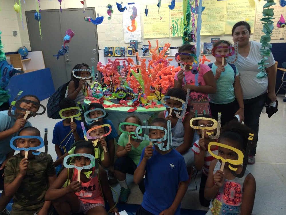 Class with colorful scuba gear cut out masks