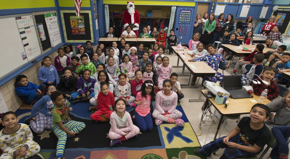 Santa with students at Bruce School