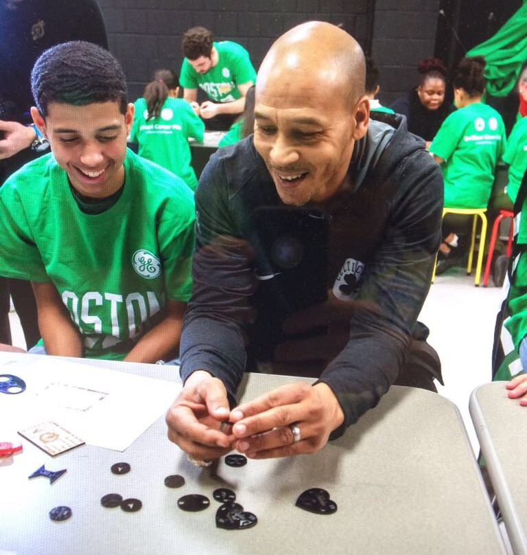 Celtics Legend Dana Barrows working with Arlington student