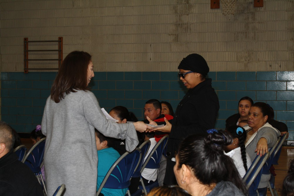 Parent receiving the award for the character trait
