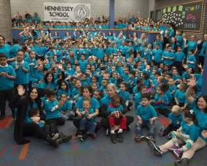 Big group of students and teachers wear blue shirts