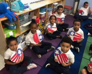 students holding patriotic hearts