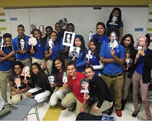 INT and PFA holding celebrity mask cut outs