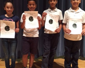 Four Wetherbee Warriors receiving awards